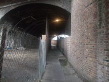 I walk down here on the way to work each day.  Its got no offical name, but I call it Diarrhea Alley, or Dead Rat Passage.